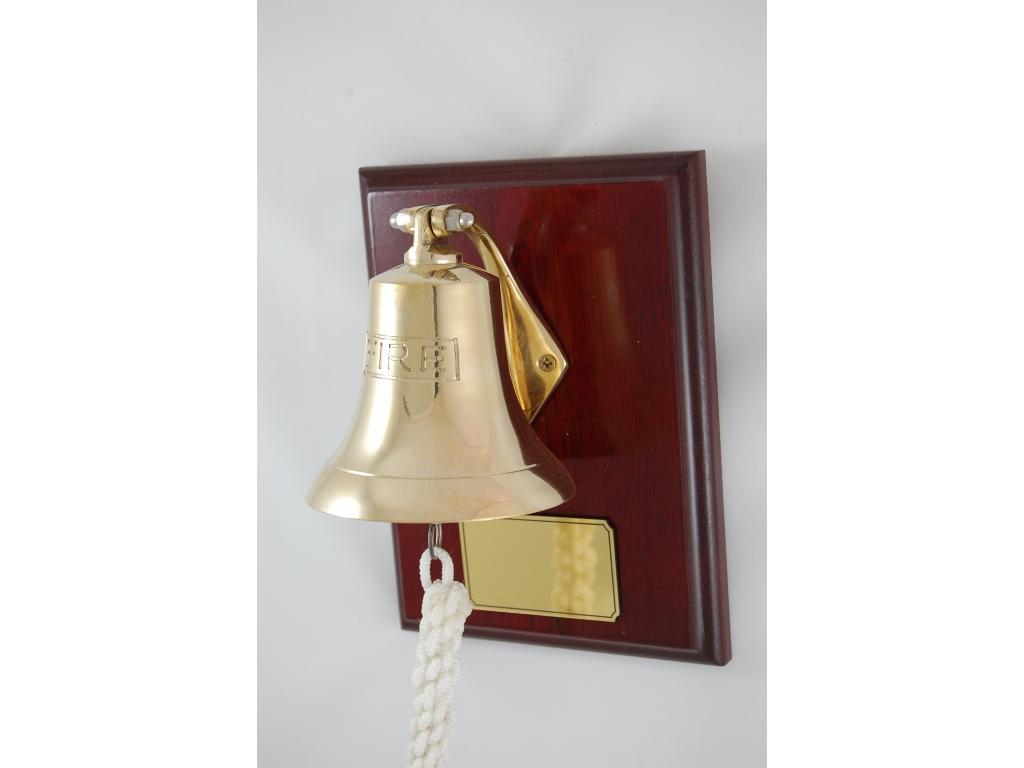 Камбана от плътен месинг,полирана, разположена на дървена поставка от махагон